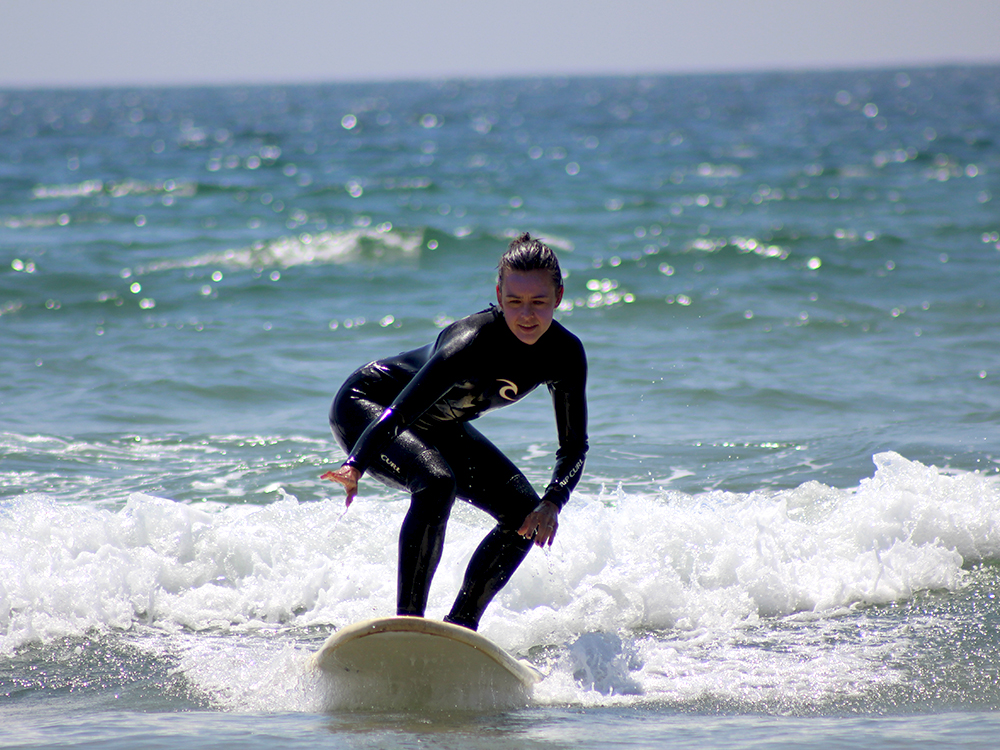 surf student on a wave