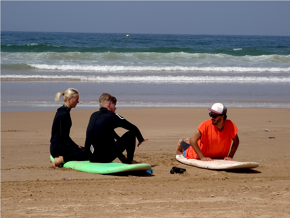 surf teacher and student